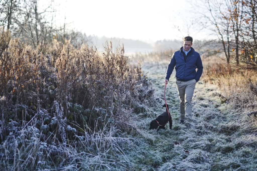 Portraiture photo of a man walking his dog - Hospitality Photographic