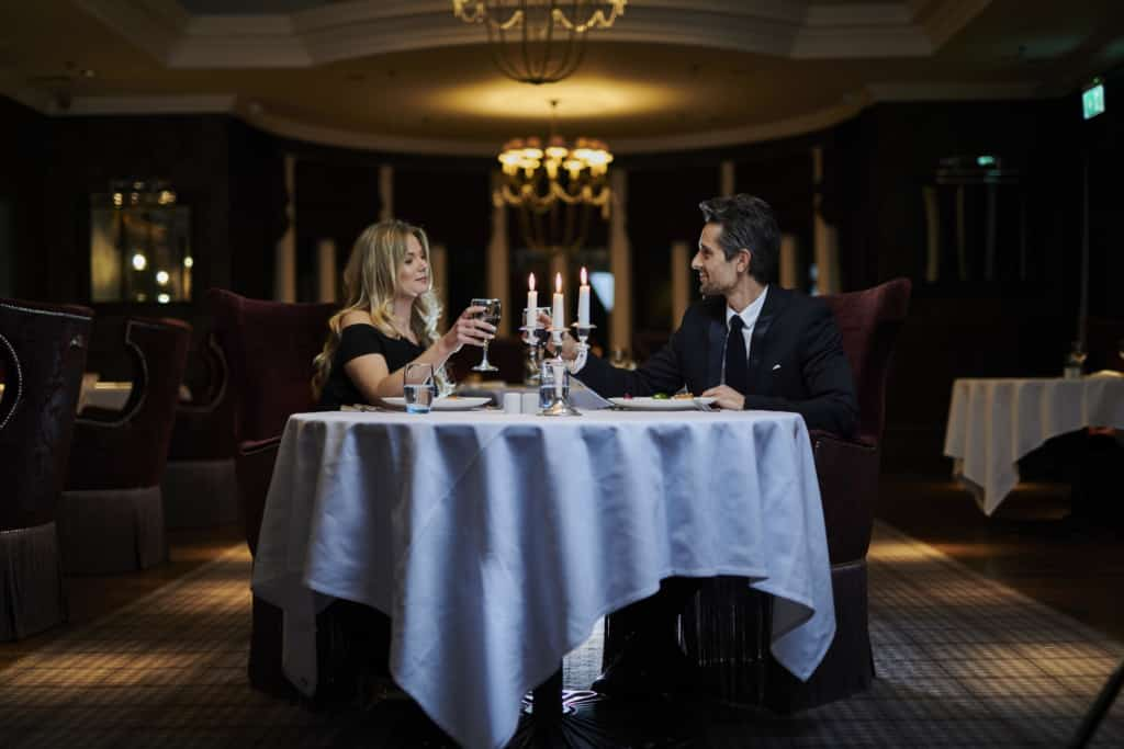 Portraiture photo of a couple at a restaurant - Hospitality Photographic