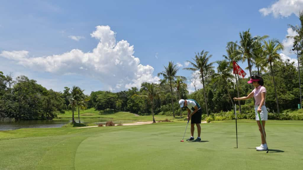 Exterior photo of a couple playing golf - Hospitality Photographic